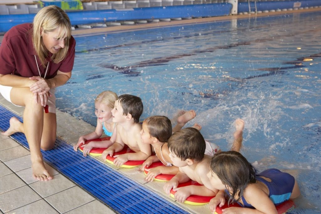 coaching children at swimming